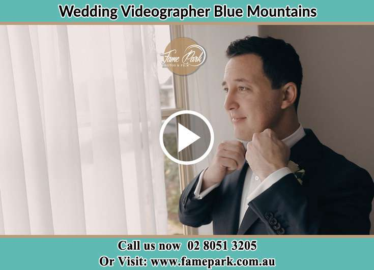 Groom doing up his tie Blue Mountains
