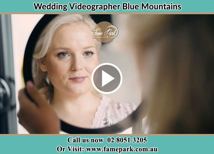 Bride looking into a mirror Blue Mountains
