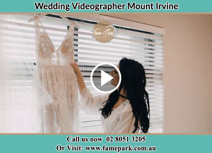 Bride looking at her dress Mount Irvine NSW 2786
