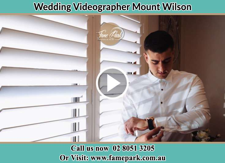 Groom looking at his watch Mount Wilson NSW 2786