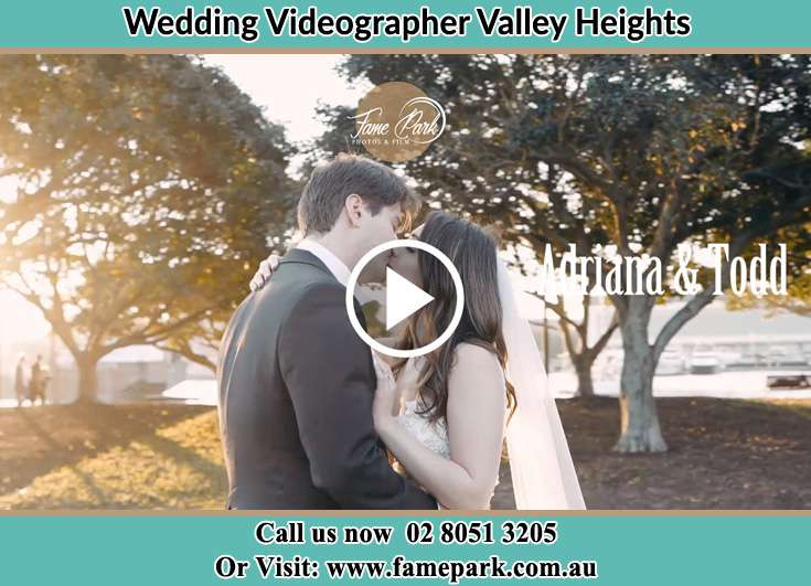 The newly weds kissing in the park Valley Heights NSW 2777