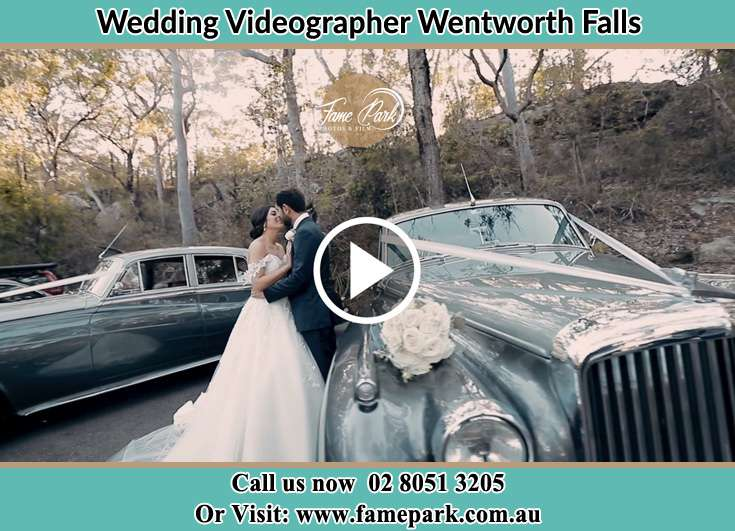The new couple about to kiss besides their wedding car Wentworth Falls NSW 2782