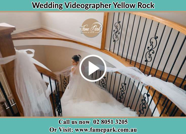 The Bride walking down the stairs Yellow Rock NSW 2770